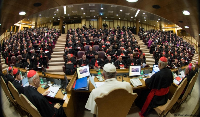 "In this handout picture released by the Vatican press office, Pope Francis (C) attends the Synod on the family on October 5, 2015, as cardinals and bishops gather in the Synod Aula, at the St Peter's basilica in Vatican. Pope Francis on October 4 defended marriage and heterosexual couples as he opened a synod on the family overshadowed by a challenge to Vatican orthodoxy by a gay priest.    AFP PHOTO / OSSERVATORE ROMANO RESTRICTED TO EDITORIAL USE - MANDATORY CREDIT ""AFP PHOTO / OSSERVATORE ROMANO"" - NO MARKETING NO ADVERTISING CAMPAIGNS - DISTRIBUTED AS A SERVICE TO CLIENTS"